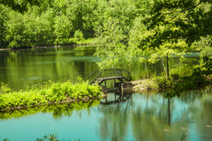 Footbridge over a tranquil lake Royalty Free Stock Photography