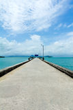 Footbridge over turquoise ocean Stock Images