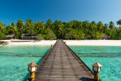 Footbridge over turquoise ocean Stock Photography