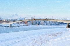 Footbridge over Volkhov river in Veliky Novgorod, Russia, in winter day Royalty Free Stock Photography