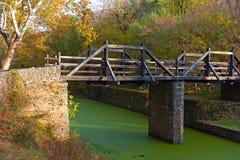 Footbridge in the park. Stock Photos