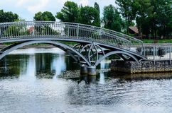Footbridge in a public park of the city Kremenchug, Ukraine. Footbridge in a public park of city Kremenchug, Ukraine Royalty Free Stock Images