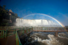 Footbridge and Rainbow in Iguazu falls national park Stock Photos
