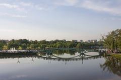 Footbridge reflecting in the pond Stock Photos