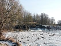 Footbridge by river Sysa and ice pieces, Lithuania Stock Image