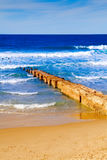 Footbridge sea sky and sandy beach Stock Photo