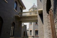 Footbridge on second floor between buildings Royalty Free Stock Photo
