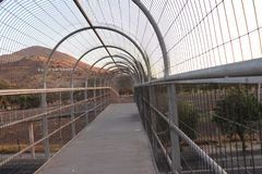 footbridge with security fence stock photography