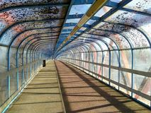 Footbridge spanning railway, afternoon light casting interesting shadows 2. Bridge disappears over the horizon, perspective draws the eye to the future and the stock photos