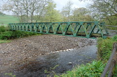 Footbridge at Stanhope. Footbridge over the river Wear County Durham Stock Photo