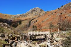 Footbridge Stickle Ghyll, Great Langdale, Cumbria. View looking up Stickle Ghyll to a footbridge on the footpath from New Dungeon Ghyll Hotel to Stickle Tarn in Royalty Free Stock Images