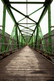 Footbridge with symmetrical metal structure. Narrow long footbridge with symmetrical metal structure Royalty Free Stock Images