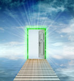 Footbridge to door leading to another dimension. Opened door leading to another dimension illustration Stock Photos