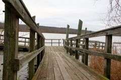 Footbridge to the lake. This setting is in the aptly named Peace Valley park in PA Royalty Free Stock Photo