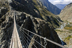 Footbridge in Trift. Trift suspension footbridge Windegg, Europe's highest situated rope suspension bridge, The Alps, Switzerland, Europe royalty free stock photography