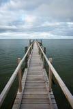 Footbridge under moody sky Stock Photo
