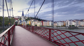 Footbridge and view of old city of Lyon at sunset, France Stock Photo