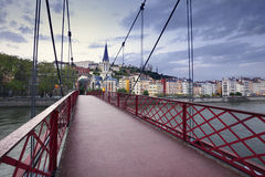 Footbridge and view of old city of Lyon at sunset, France Stock Image