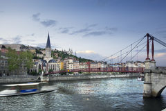 Footbridge and view of old city of Lyon before sunset, France Stock Photos