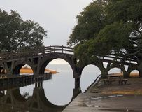 Footbridge with a History. The footbridge at the Whale`s Head Duck Hunting club casts a mirror image in calm, still waters Royalty Free Stock Photo