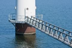 Footbridge of a windmill in the se. Footbridge for maintenance of a windmill standing in the sea; the Netherlands stock photo