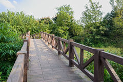 Footbridged with balustrades over water on sunny day Stock Images