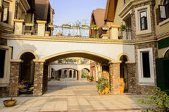 Footbridges between European style buildings in sunny autumn aft Stock Photography