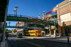 Footbridges to Centro Ybor entrance with yellow tram underneath Royalty Free Stock Images