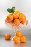 Footed Bowl with Tangerines Stock Image