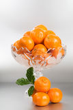 Footed Bowl with Tangerines Stock Photos