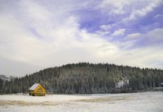 Foothills Cabin. A small cabin the snowy foothills of the Rocky mountains stock photos