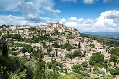 Gordes, provincial hilltop Town. On the foothills of the Mountains of Vaucluse, facing the Luberon, Gordes is one of the most well-known hilltop villages in Stock Image