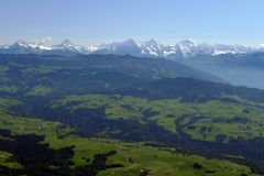 Foothills of the swiss alps. And the high alps in the background royalty free stock photo