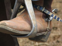 Foothold. Cowboy Boot in stirrup Stock Photos