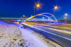 Foothpath bridge over bypass of Gdansk. At night, Poland Stock Photo