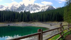 Foothpath to mountain Lake Carezza in the Alps at sunrise stock video