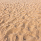Footmarks on sand and sand texture Royalty Free Stock Image