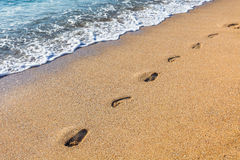Footmarks on the sandy beach Royalty Free Stock Photography