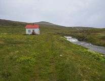 Footpath in abandoned village Heysteri in Iceland West fjords in stock photography