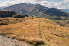 Footpath across grassy hills in Southern Alps Royalty Free Stock Image