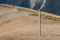 Footpath across scree slope with poles marking way Stock Images