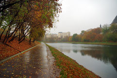 Footpath along a pond's bank. Footpath in autumn park along a pond's bank in Moscow stock image