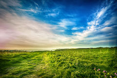 Footpath along the sea. A public footpath along the sea at the sunrise against cloudy blue sky Royalty Free Stock Images