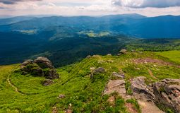 Footpath amoung huge rocks on the edge of a hill. Footpath among huge rocks on the edge of a hill. beautiful valley view from the top Royalty Free Stock Image