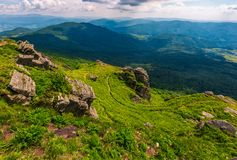 Footpath amoung huge rocks on the edge of a hill. Footpath among huge rocks on the edge of a hill. beautiful valley view from the top Royalty Free Stock Images