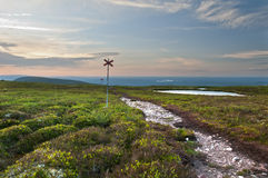 Footpath in the bare mountain. Towards blue mountains and evening sky Royalty Free Stock Photo