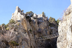 Footpath bridge holding between two mountains Royalty Free Stock Image
