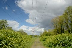 Country lane under the power lines Stock Photos