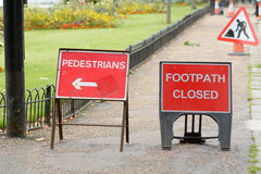 Footpath Closed and Pedestrians this way signs Royalty Free Stock Photos