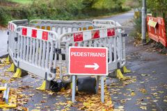 Footpath closed sign for pedestrian safety from road construction on busy street. Uk stock photos